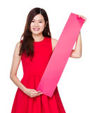 Asian woman with red banner Royalty Free Stock Photo