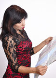 Asian woman red black dress reads travel map Stock Images