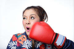 Asian woman with red boxing glove punch her face Stock Photography