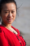 Asian woman in red coat Royalty Free Stock Image