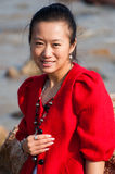 Asian woman in red coat Stock Images