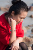 Asian woman in red coat Stock Photos