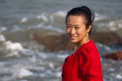 Asian woman in red coat Royalty Free Stock Photography