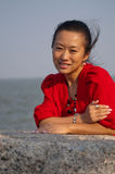 Asian woman in red coat Stock Photo
