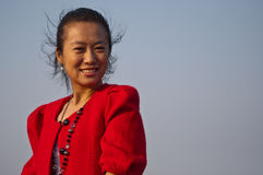 Asian woman in red coat Royalty Free Stock Photos