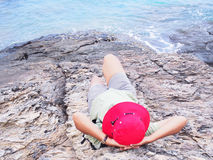 Asian woman with red hat relaxing at summer beach Royalty Free Stock Photo