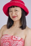Asian Woman in Red Hat and Top Royalty Free Stock Photography