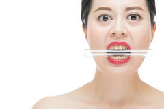 Asian woman red lips nail and bite test lab tube. Sexy asian woman red lips nail and bite chemistry test lab tube, isolated on white background Royalty Free Stock Photo