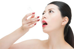 Asian woman red lips nail and eat test lab tube. Sexy asian woman red lips nail and eat chemistry test lab tube, isolated on white background Stock Photos