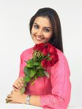 Asian woman with red roses stock photography
