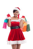 Asian woman in red santa costume with colorful shopping bags Stock Photography