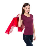 Asian woman with red shopping bag Stock Photography