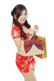 Asian woman in red traditional Chinese cheongsam with shopping b Stock Images