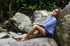 Asian woman relax on the rock Stock Photos