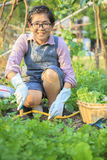 Asian woman relaxing activitiies in home garden Royalty Free Stock Image