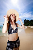 Asian woman relaxing on the beach Royalty Free Stock Image