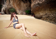 Asian woman relaxing on the beach Stock Images