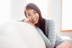 Asian woman relaxing on couch. At home in the living room Royalty Free Stock Photos