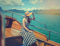 Asian woman relaxing on cruise with sunny day. Stock Photos