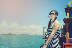 Asian woman relaxing on cruise with sunny day. Royalty Free Stock Images