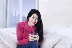 Asian woman relaxing with a cup of tea Stock Images