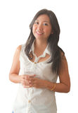 An Asian woman relaxing with drinking water Stock Image
