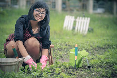 Asian woman relaxing happiness emotion planting organic  vegetab Stock Image