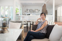 Asian woman relaxing at home. Stock Photography