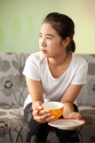 Asian woman relaxing hot coffee. Stock Image