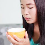 Asian woman relaxing hot coffee. Royalty Free Stock Photo