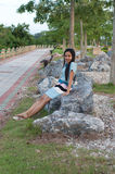 Asian woman relaxing in park Stock Photo