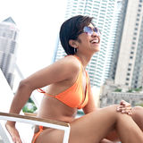 Asian woman relaxing by the pool Royalty Free Stock Photography