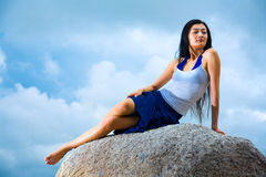 Asian woman relaxing on the rock Stock Images