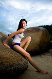 Asian woman relaxing on the rock Royalty Free Stock Photography