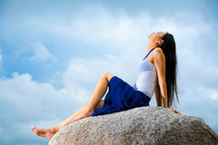 Asian woman relaxing on the rock Stock Photos