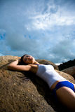 Asian woman relaxing on the rock Royalty Free Stock Photos