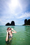 Asian woman relaxing on the sea Royalty Free Stock Images