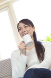 Asian woman relaxing on the sofa Royalty Free Stock Image