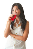An Asian woman relaxing with soft drink Royalty Free Stock Images