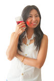 An Asian woman relaxing with soft drink Stock Images