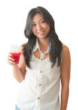 An Asian woman relaxing with soft drink Stock Photography