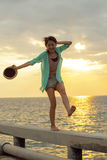 Asian woman relaxing summer vacation at sea beach against beauti Stock Image