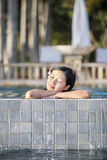 Asian woman relaxing in swimming pool Royalty Free Stock Photography