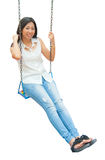 An Asian woman relaxing on a swing Stock Photos