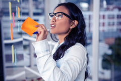 Asian woman removing sticky note Stock Images