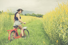 Asian woman riding bicycle Stock Image