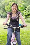 Asian woman riding bicycle Royalty Free Stock Images