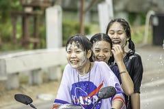 Asian woman Riding a motorcycle play water and flour in Songkran festival or Thai new year in Thailand at Bang kruai, Nonthaburi stock photos
