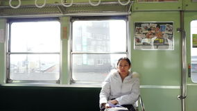 Asian woman riding in train in sunny day stock footage