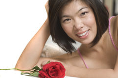 Asian woman with Rose. Beautiful young Asian woman laying down with Rose Stock Photography